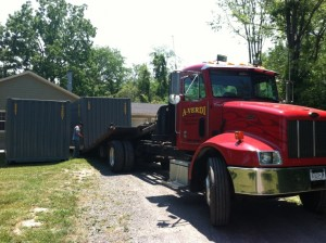Delivery Specialist Dropping Off 2 20' Shipping Containers